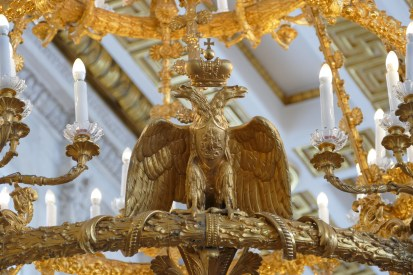 Detail from a brass chandelier showing the Russian imperial two headed eagle