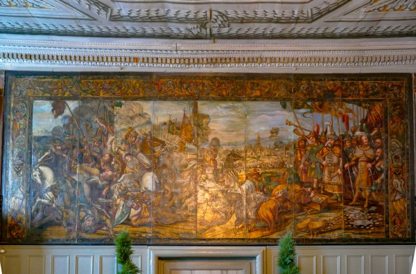 Gilded leather wall painting showing the Ottoman seige of Vienna in 1683