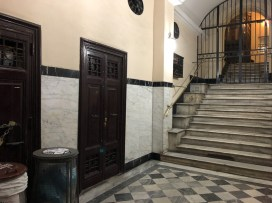 The entrance lobby and stairs leading to the lift.