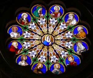 Stained glass window depicting the saints of the Dominican Order.