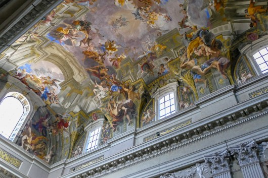 The magnificent trompe l'oeil ceiling. The figures seem to be floating in mid-air.