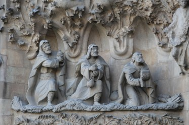 The facade is covered with finely detailed carvings illustrating stories from the birth of Jesus.
