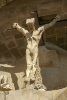 The hair of the crucified Christ is an open book, symbolising the word of God