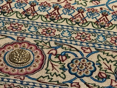 """A close up of the Pearl Carpet of Baroda """"the most extravagant carpet ever made"""". Made in 1865 to cover the tomb of Mohammed. It has over 1 million seed pearls, as well as rubies, emeralds, diamonds and sapphires."""