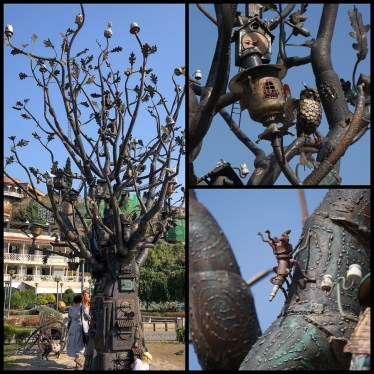 "This ""tree"" in Rike Park is a large steampunk style sculpture"