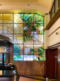 Stained glass panels depicting (naturally) the wine harvest.