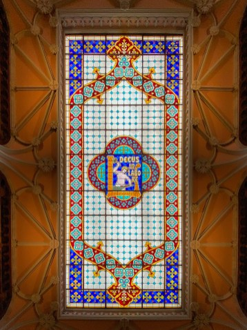 "The stained glass panel ceiling ""Decus in Labore"" (Honour in work), the motto of the Lello brothers."