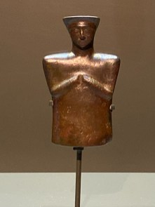 Copper alloy cosmetic flask in the form of a stylised woman. Bactria-Margiana, Late 3rd to early 2nd millennium BCE
