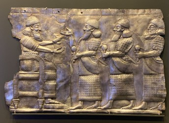 Silver plaque with court scene. Probably Assyria or northwestern Iran. 8th to 7th century BCE