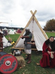 Son2 suiting up for the SMR showfight, standing in front of the Viking tent he made.