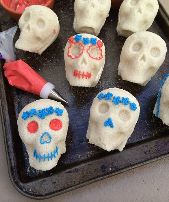Mexican sugar skulls being decorated