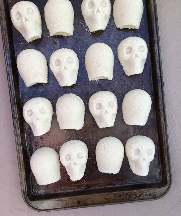 sugar skulls drying out before being decorated with royal icing