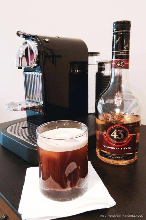 Nespresso Citiz machine with Licor 43 and an iced carajillo cocktail
