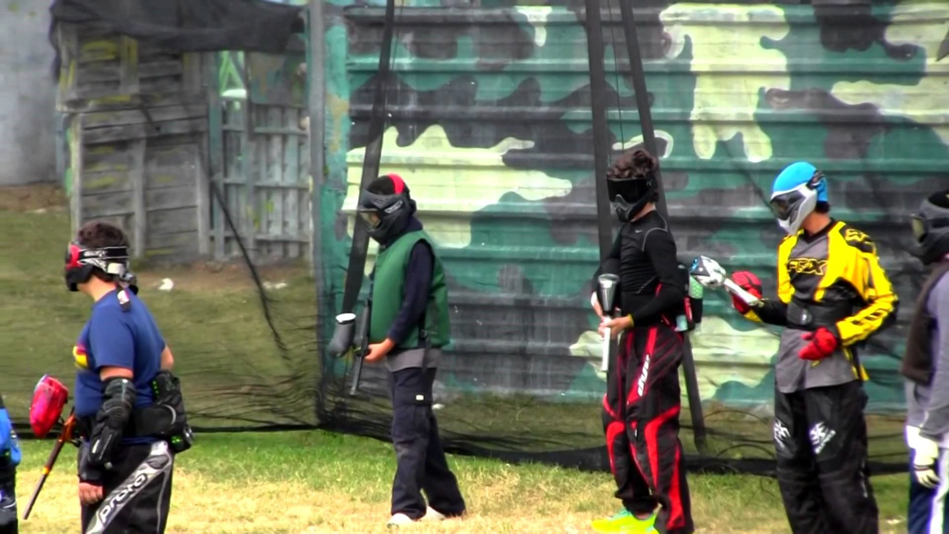 Practice paintball with team members