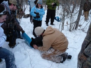 Dave McFarland adds lubricating ointment and closes the eyelids of a sedated boar cub.