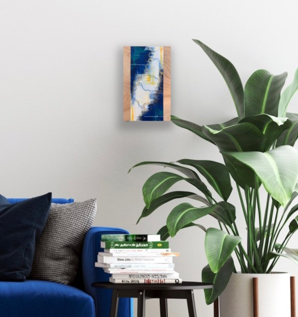 abstract painting on wood above end table