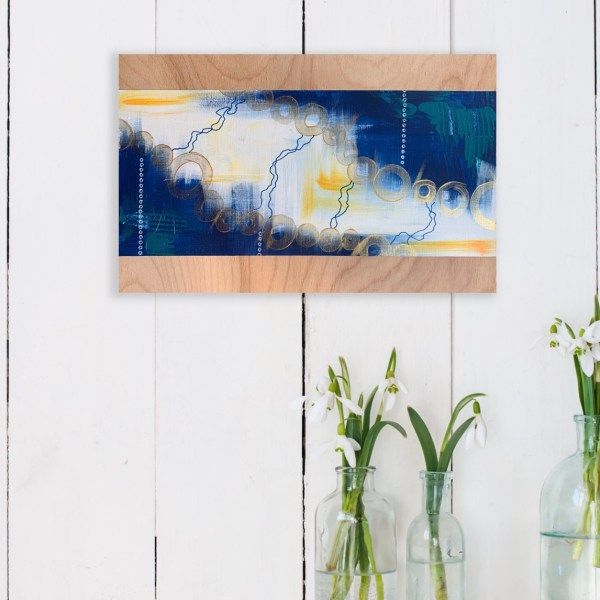 abstract painting on wood hung on wall