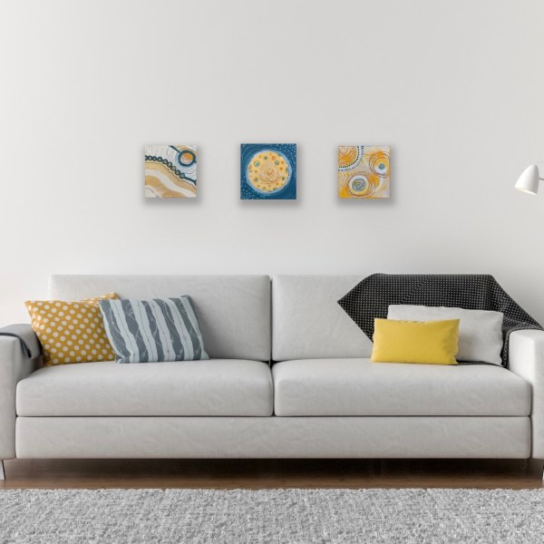 set of 3 abstract paintings above couch