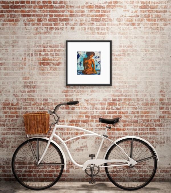 framed figure painting on exposed brick