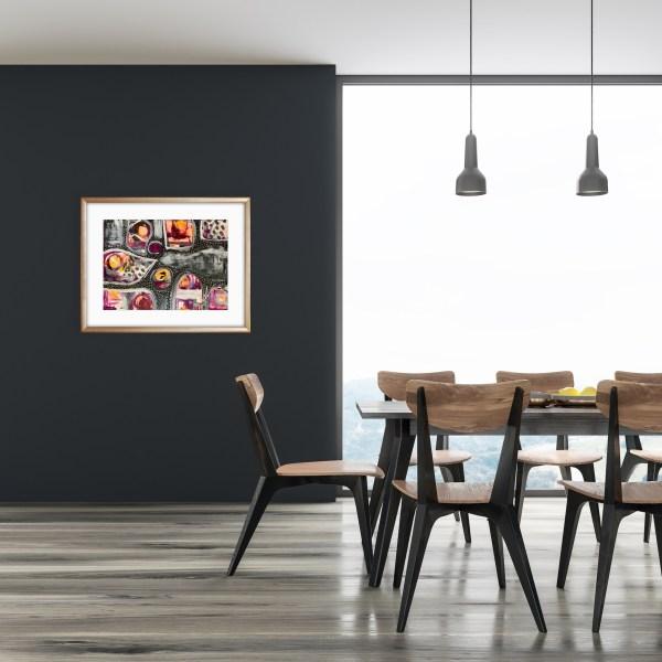 framed abstract art in dining room