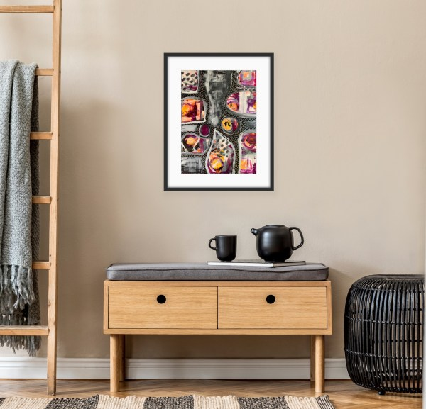 framed abstract art above bench
