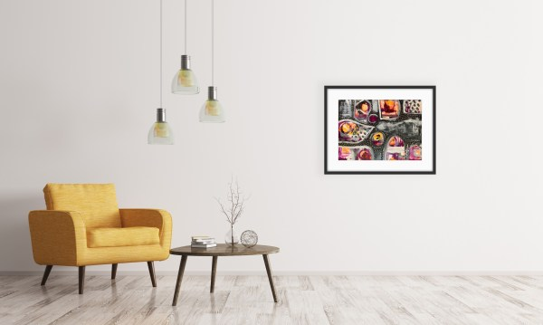 framed abstract art in living area