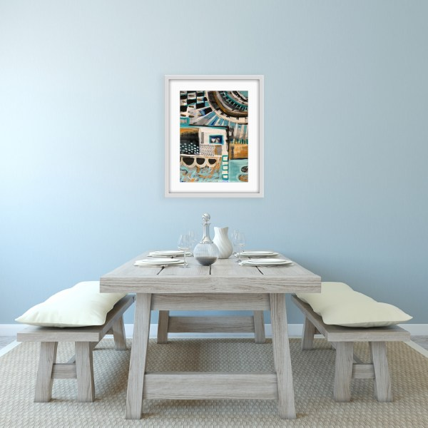 framed abstract painting above dining table