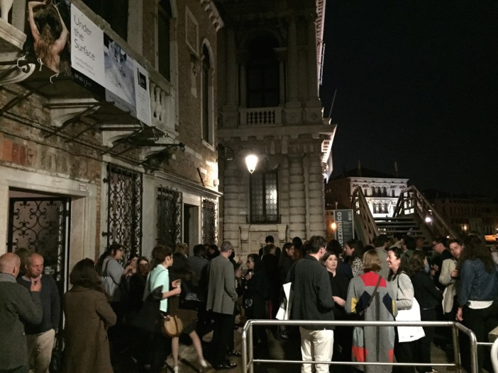 Guests from the international art world gather to view the work of NL artists on the banks of the canal, Venice Biennale 2015.