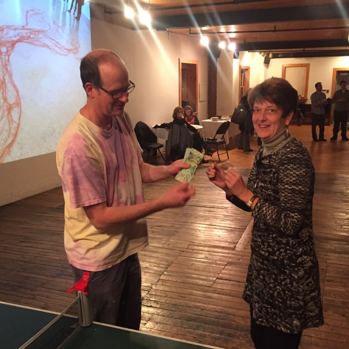 Big winner Debbie Petite receives her winnings at Chase the Ace for Arts Sake