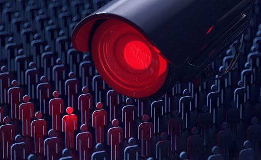 A red-lensed camera leers down at a crowd of 2-d stick figures. One lights up red under its gaze. The rest are cast in heavy shadow.