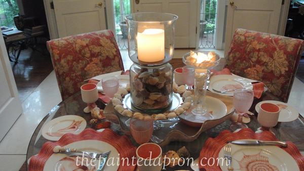 candle lit shell table thepaintedapron.com