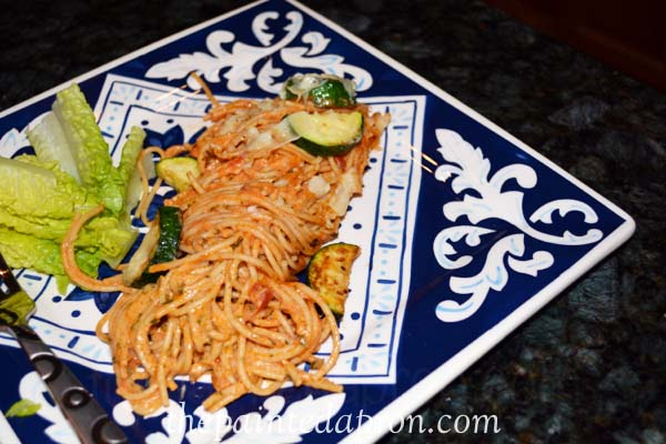 pesto pasta with tomato and zucchini thepaintedapron.com