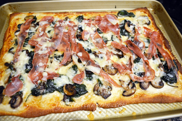 spinach, prosciutto pizza with sesame crust thepaintedapron.com