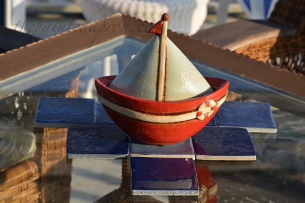 sail boat on a tile sea