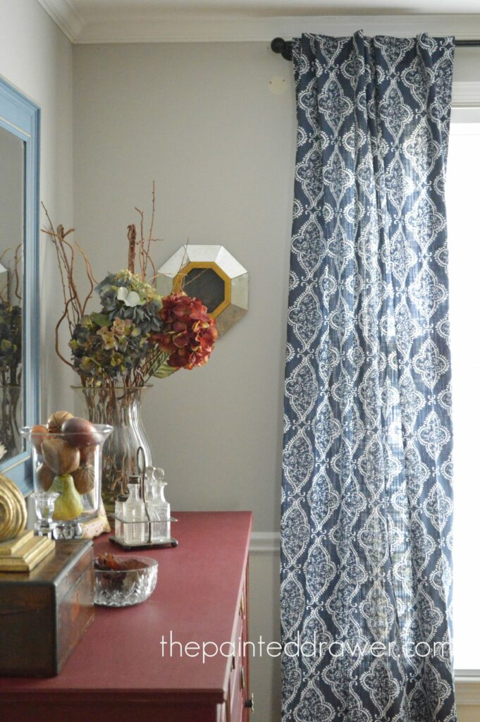 rug under kitchen table exhaust fan the dining room and a pop of blue
