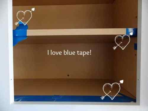 The inside of my cabinets were in great shape, so I decided not to paint them. I just taped off the edges to keep them nice and tidy.