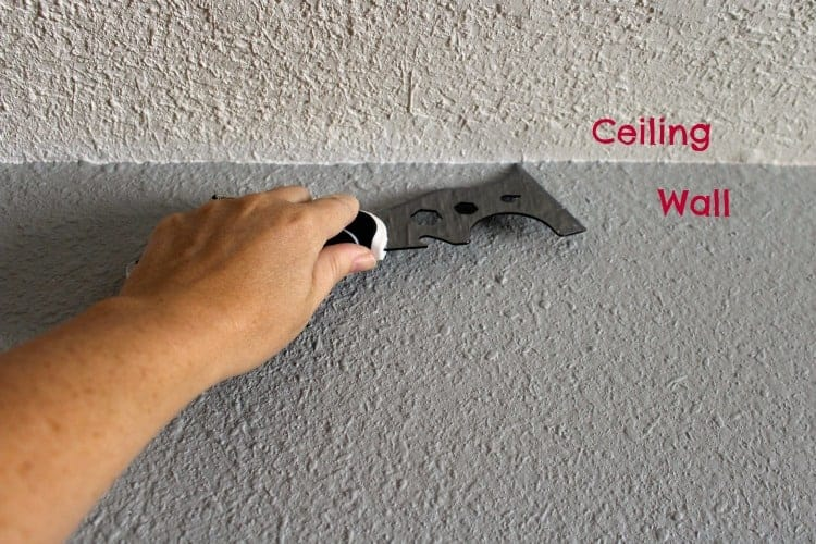 The trick to getting that perfect line when painting between ceiling and wall.