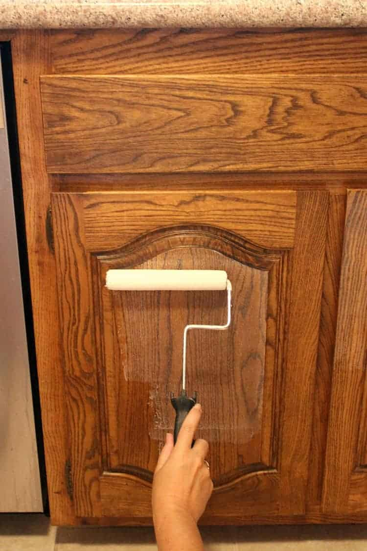 Applying primer to kitchen cabinets