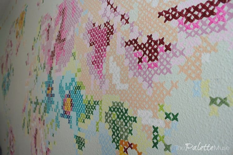 Detail of giant painted cross stitch mural