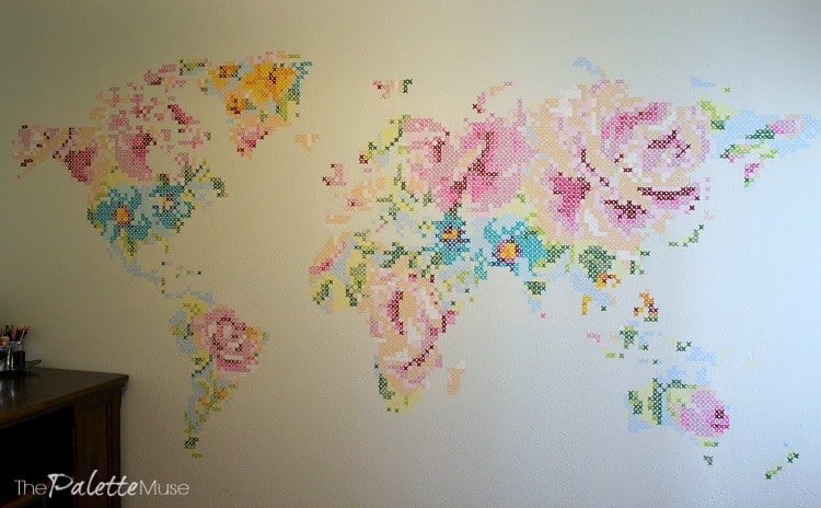 Giant mural of a colorful cross stitch floral map