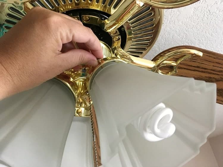 Remove light shades by loosening three screws at the top.
