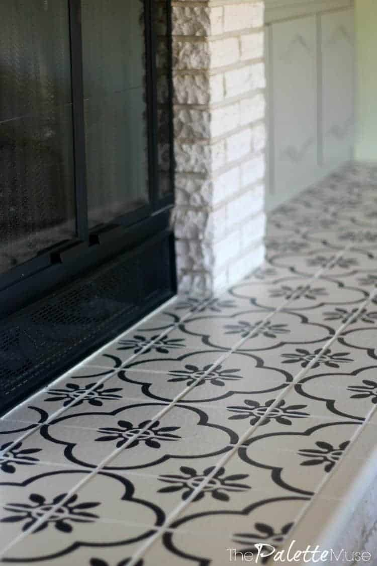 Fireplace hearth tile painted in concrete tile pattern
