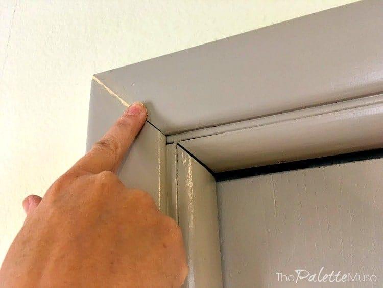 Wood filler fills in the gaps in the closet door trim.