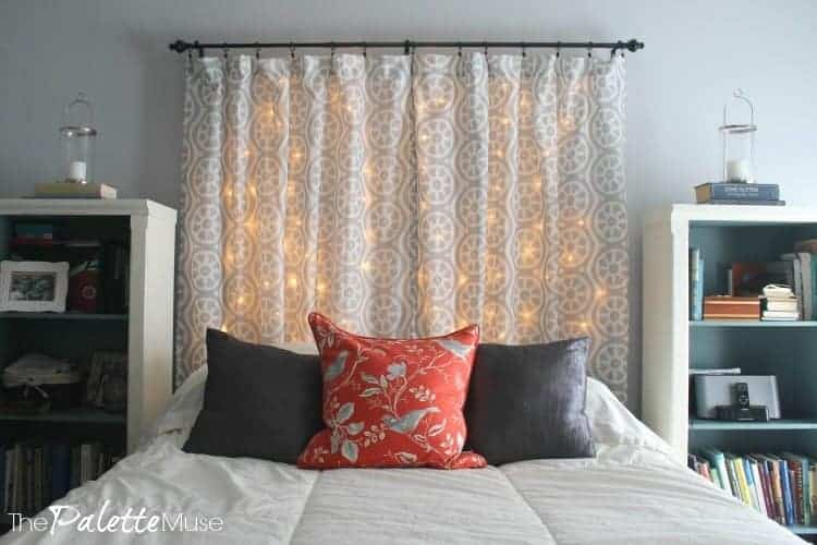 Lit headboard during the day, with bookshelves as bedside tables