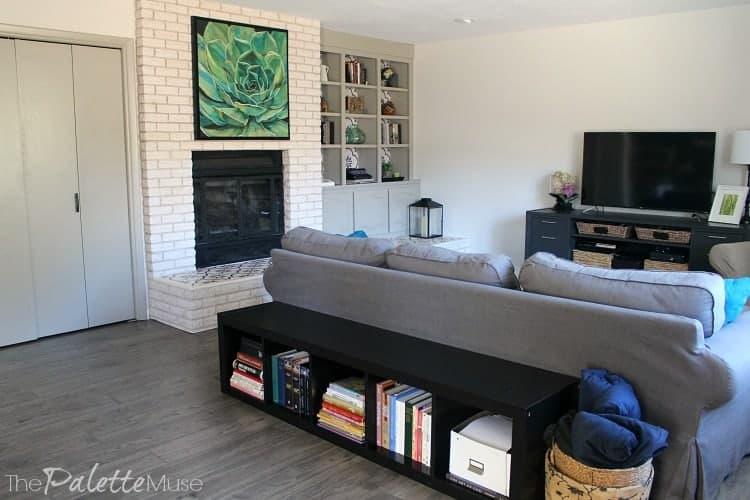 Living room put back together after installing waterproof laminate flooring