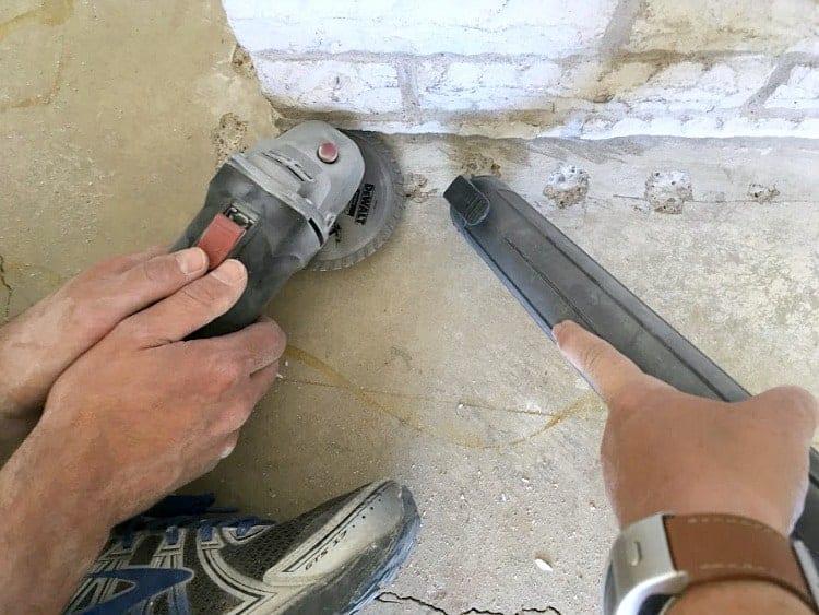 Undercutting stone hearth for instaling laminate flooring