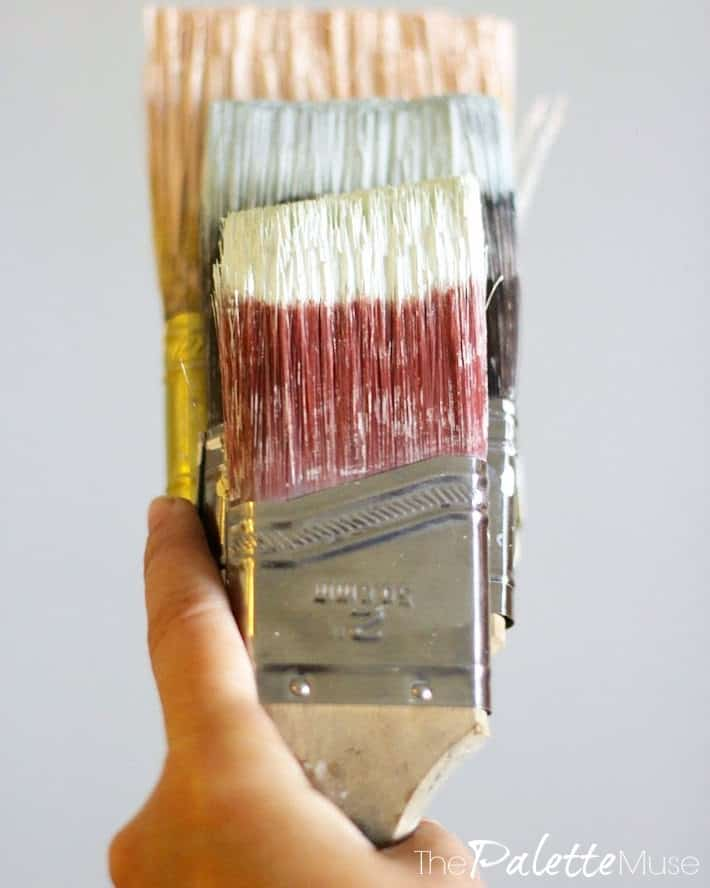 Multiple paint brushes with different colors of paint