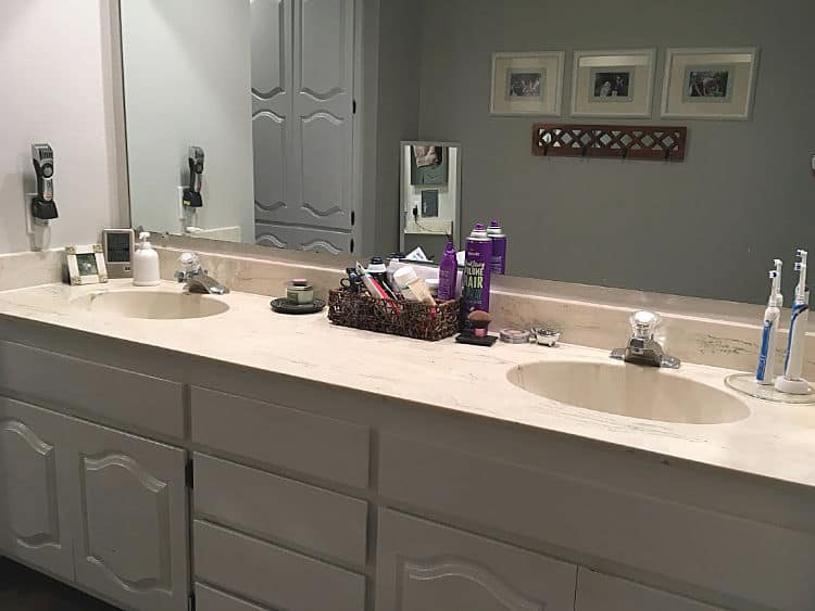White cabinets help, but this bathroom is still dated and dark.