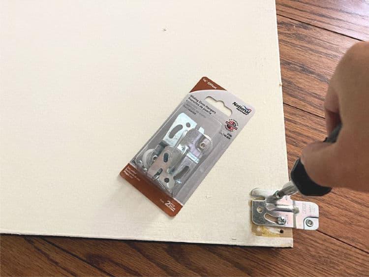 Replacing broken roller on sliding closet door with a new roller bracket