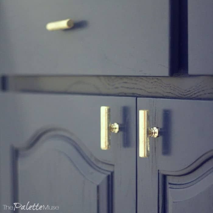 Dark blue cabinets with silver mercury hardware